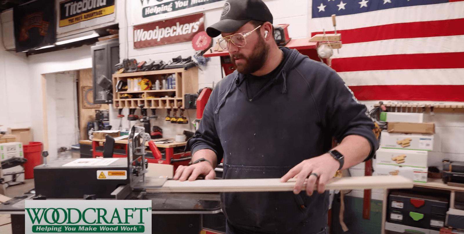 John Malecki cutting wood