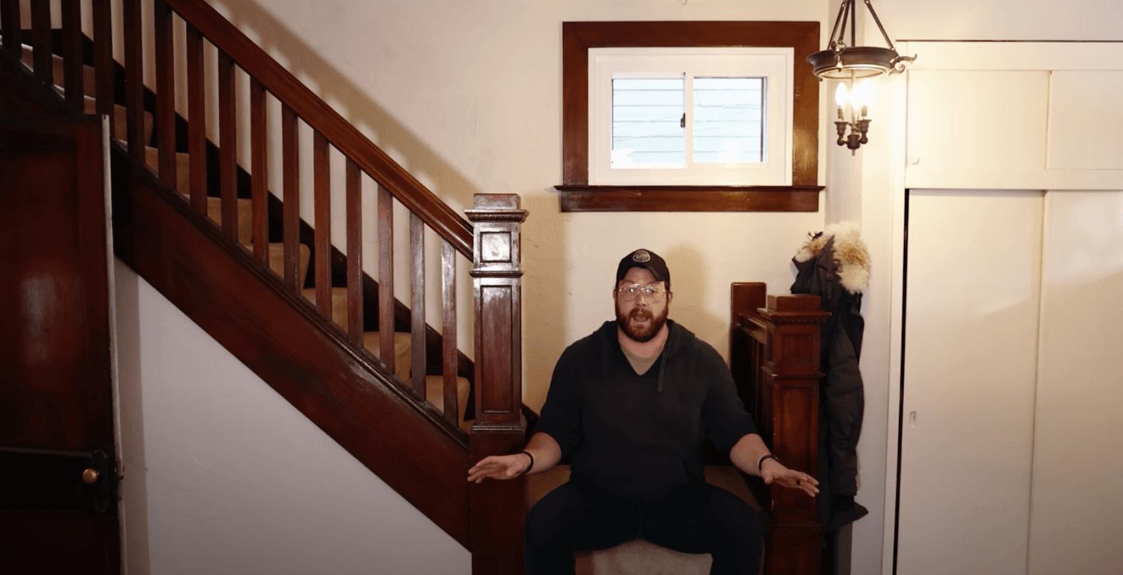 John Malecki sitting on stairs