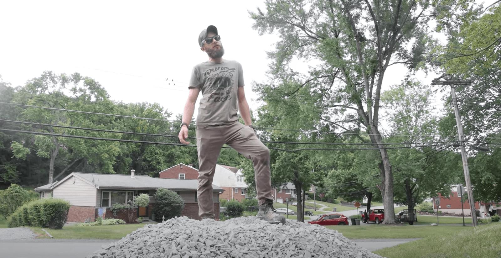 Sam standing on a pile of gravel