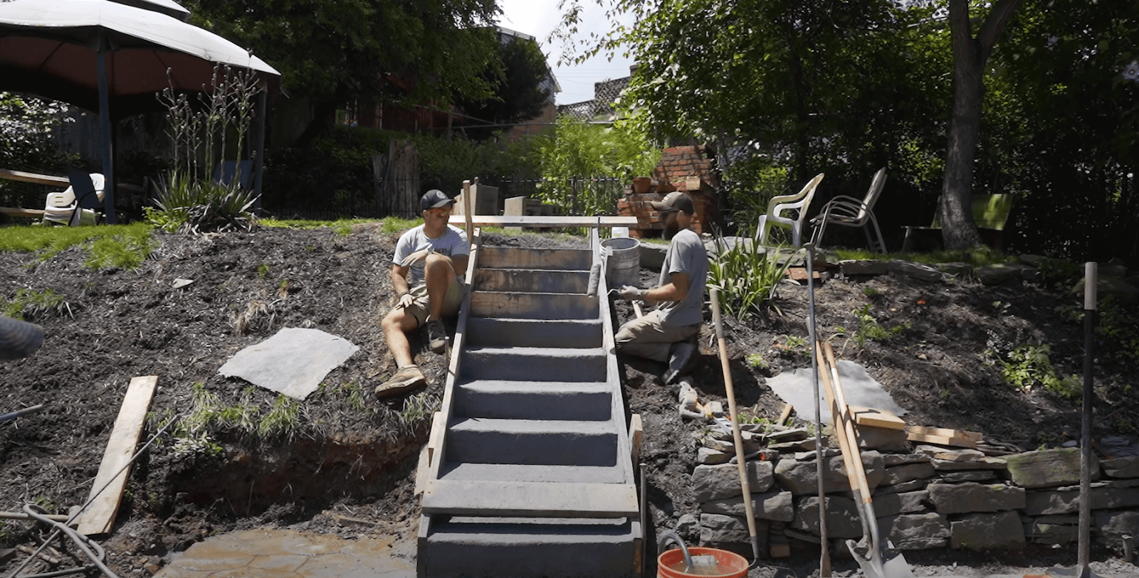Sam and Jordan working on the concrete stairs