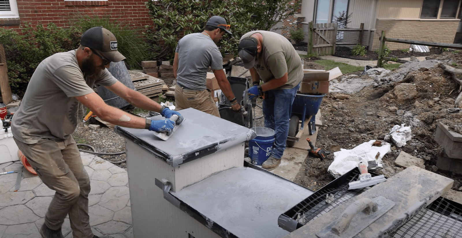 John, Sam, and Jordan working on the cement countertops