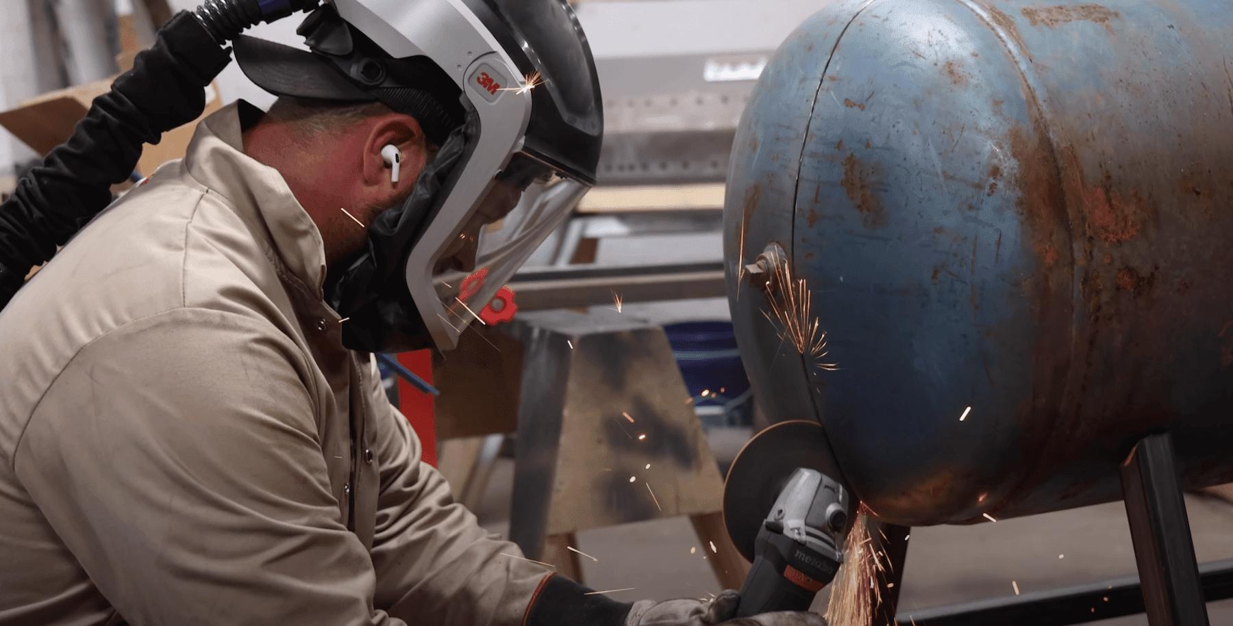 John Malecki working on smoker build