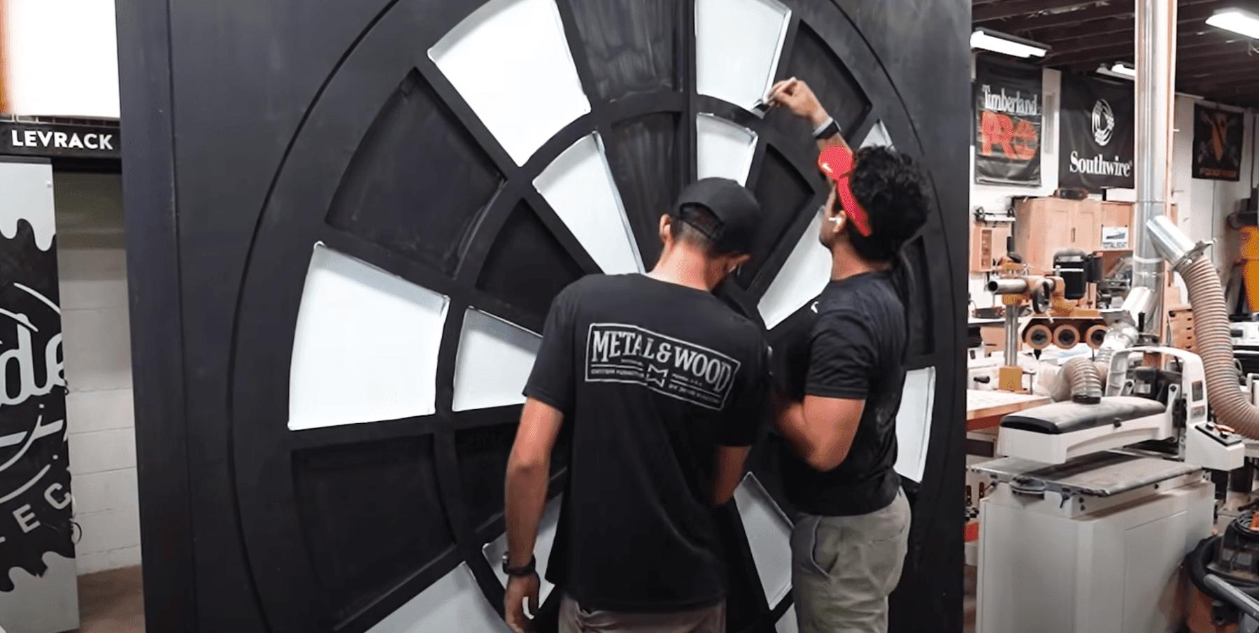 Sam and Jordan building massive dartboard