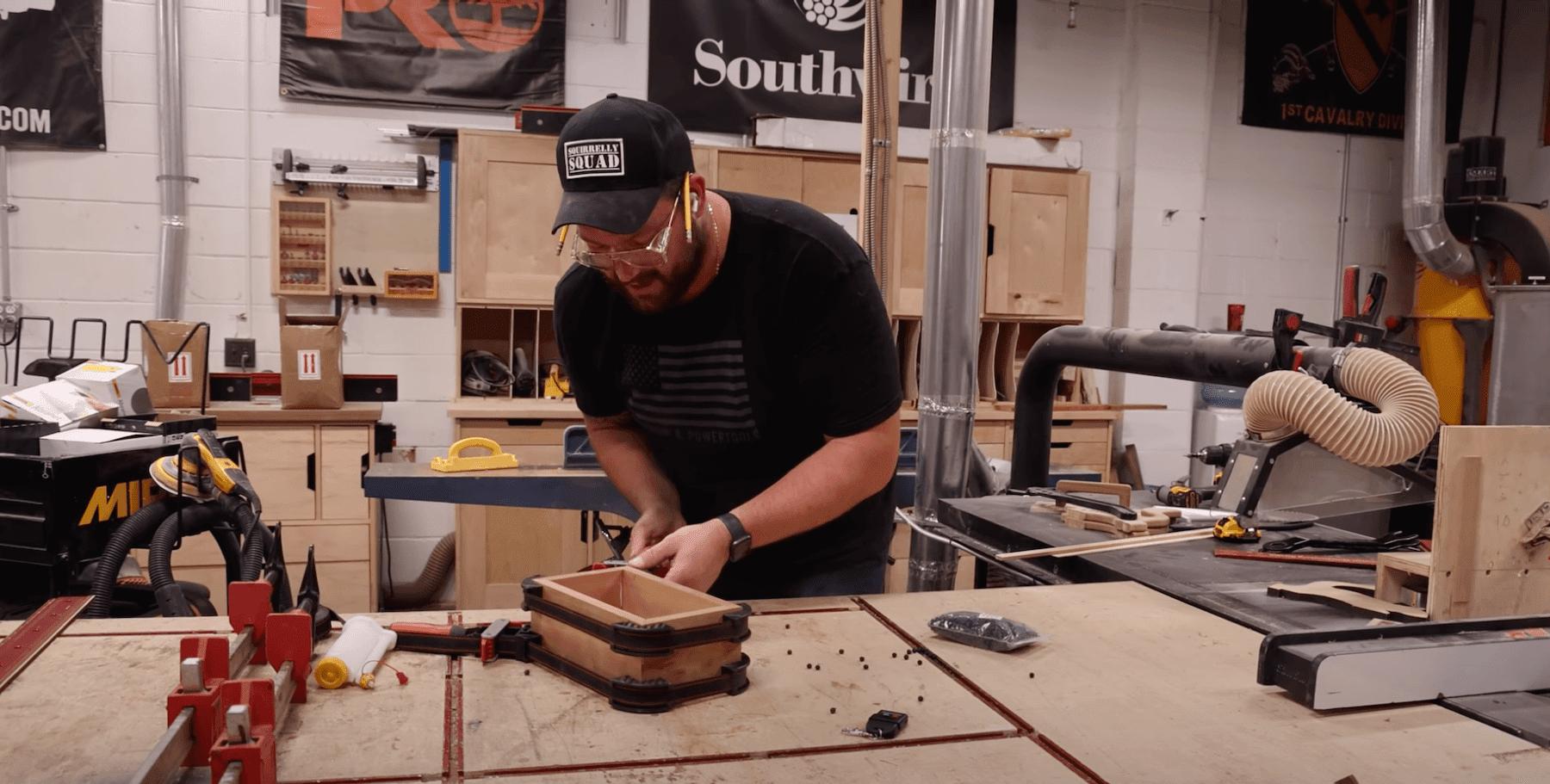 John Malecki gluing his box