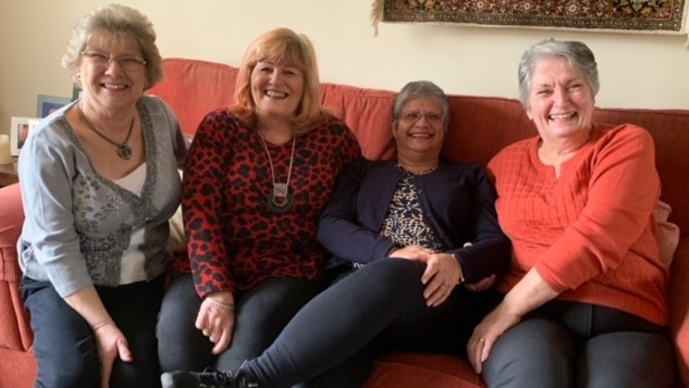Four carers from the West Kent PF Support Group laughing