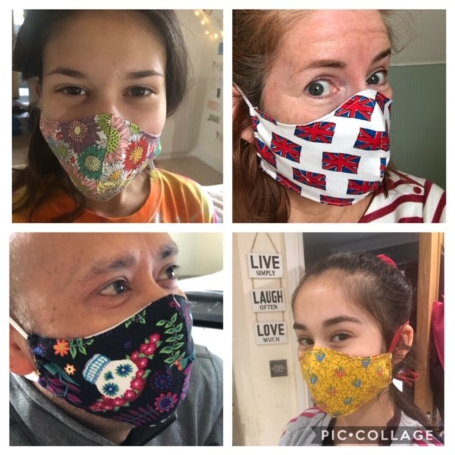 Lesley and her family modelling her masks