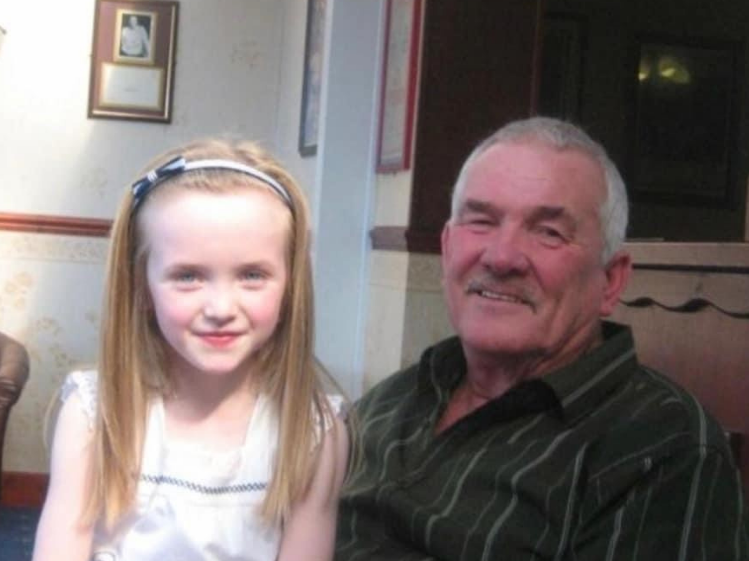 A childhood photo of Mia-Beth and her Grampa Gerwyn Davies