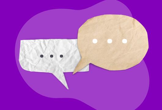 two speech bubbles on a purple background