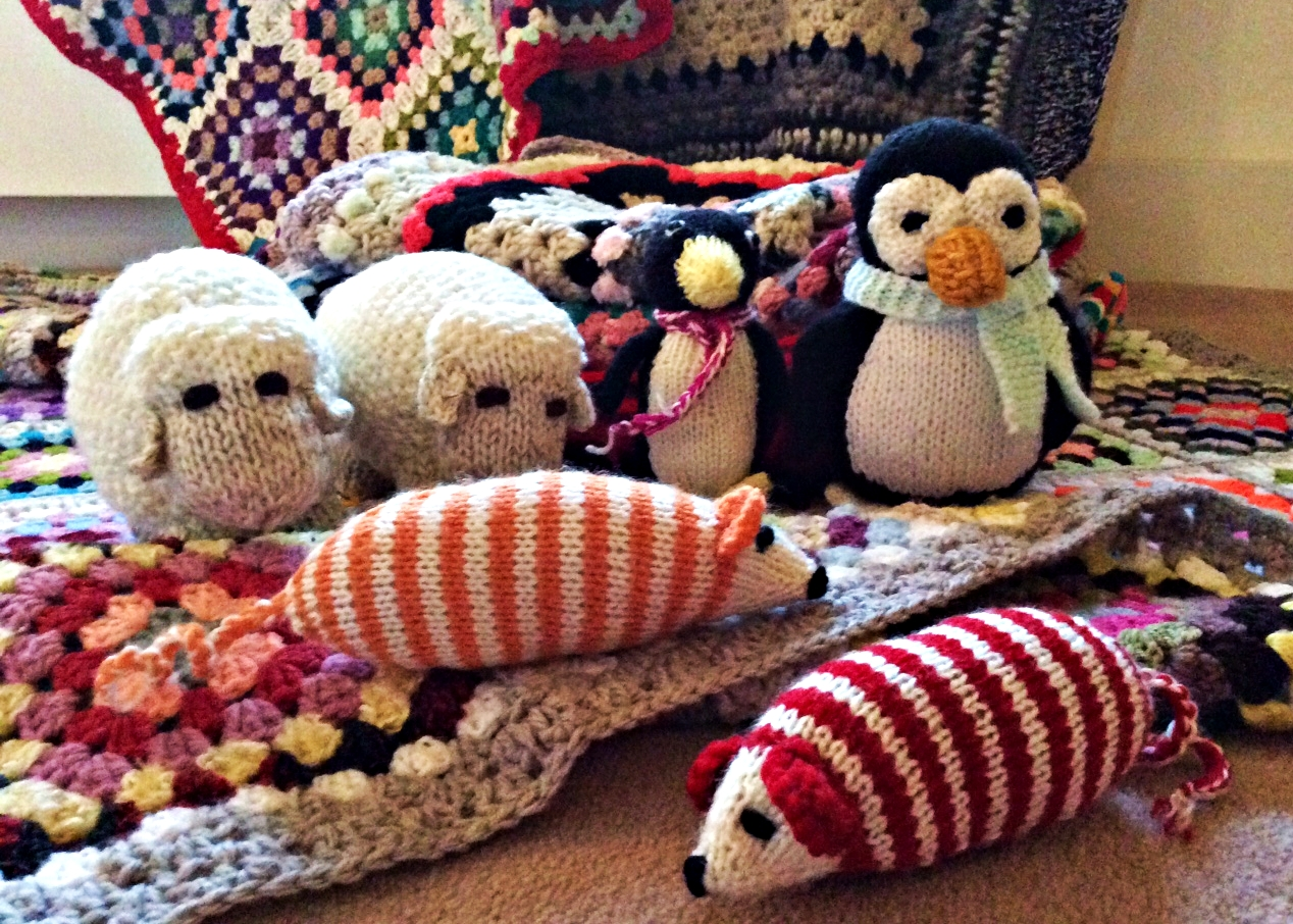 Beautiful knitted and crocheted blankets, toys and dog coats