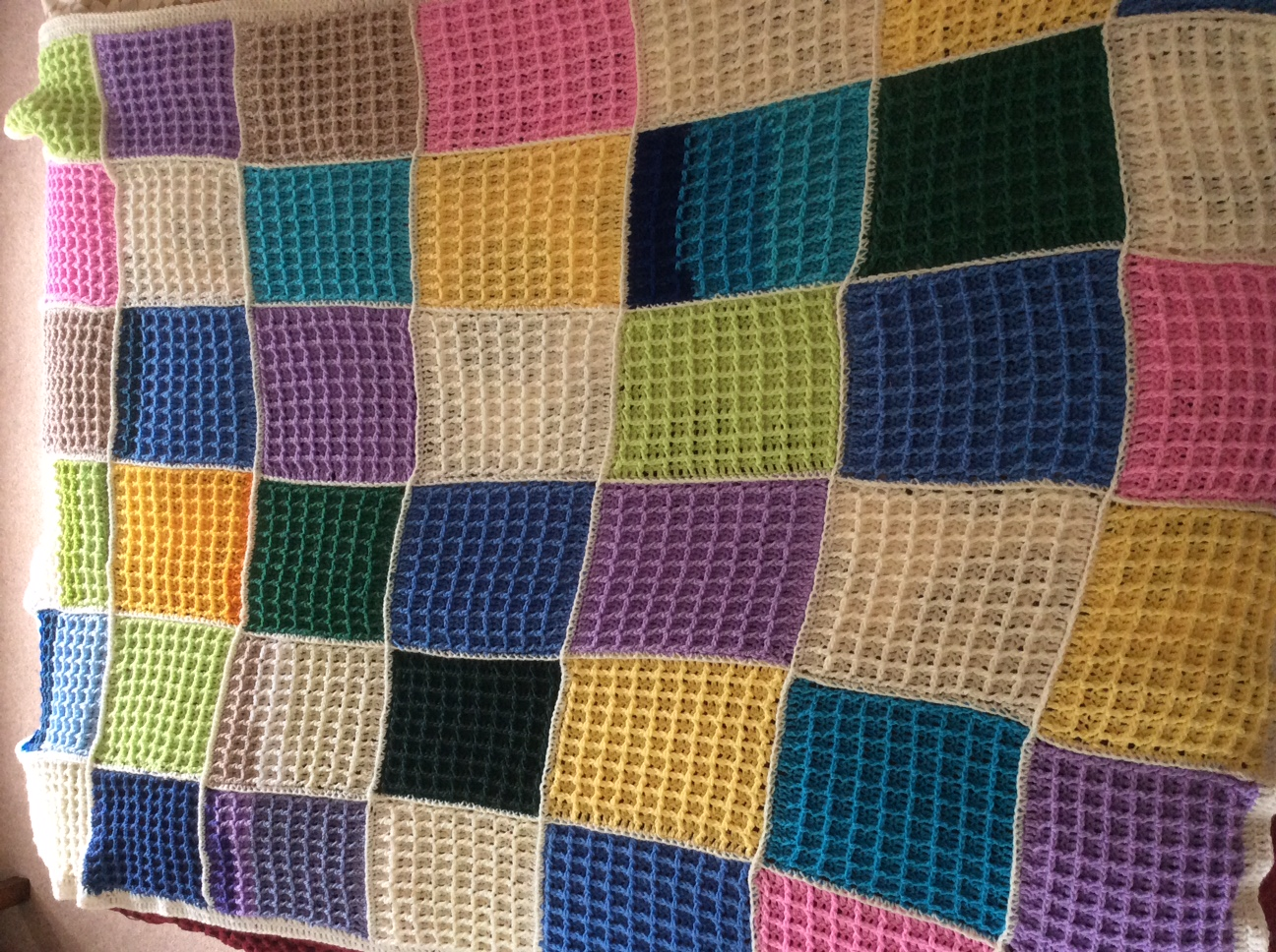 Beautifully crocheted large throw in multi-coloured squares