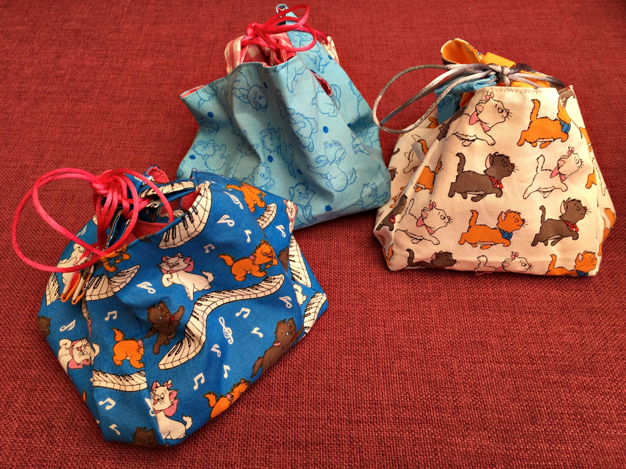 Dinky fabric keepsake bags or dressing table holders - with kittens galore on them!