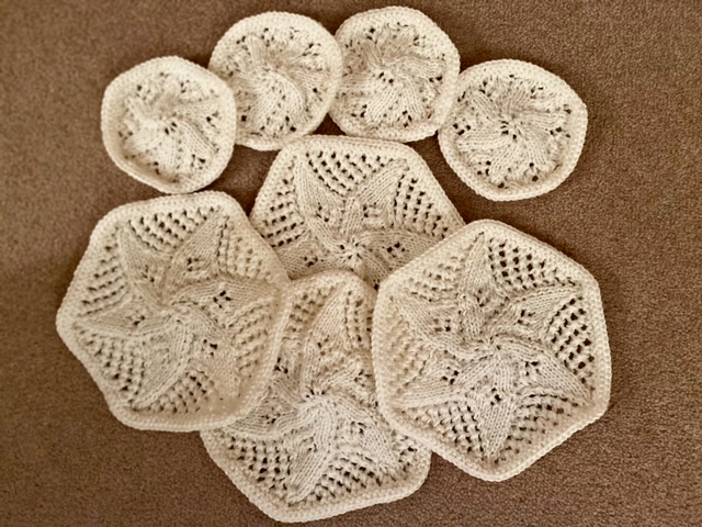 White crocheted coasters or pot stands