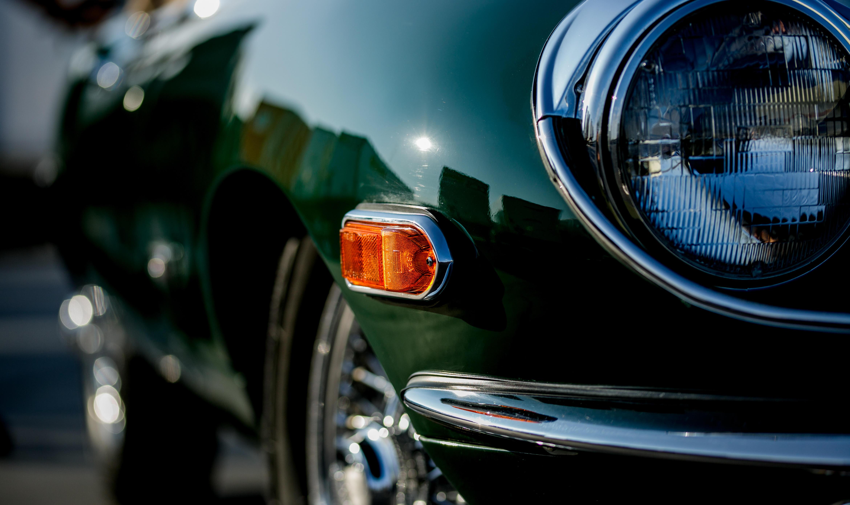 Close up of a green Jaguar E Type headlight