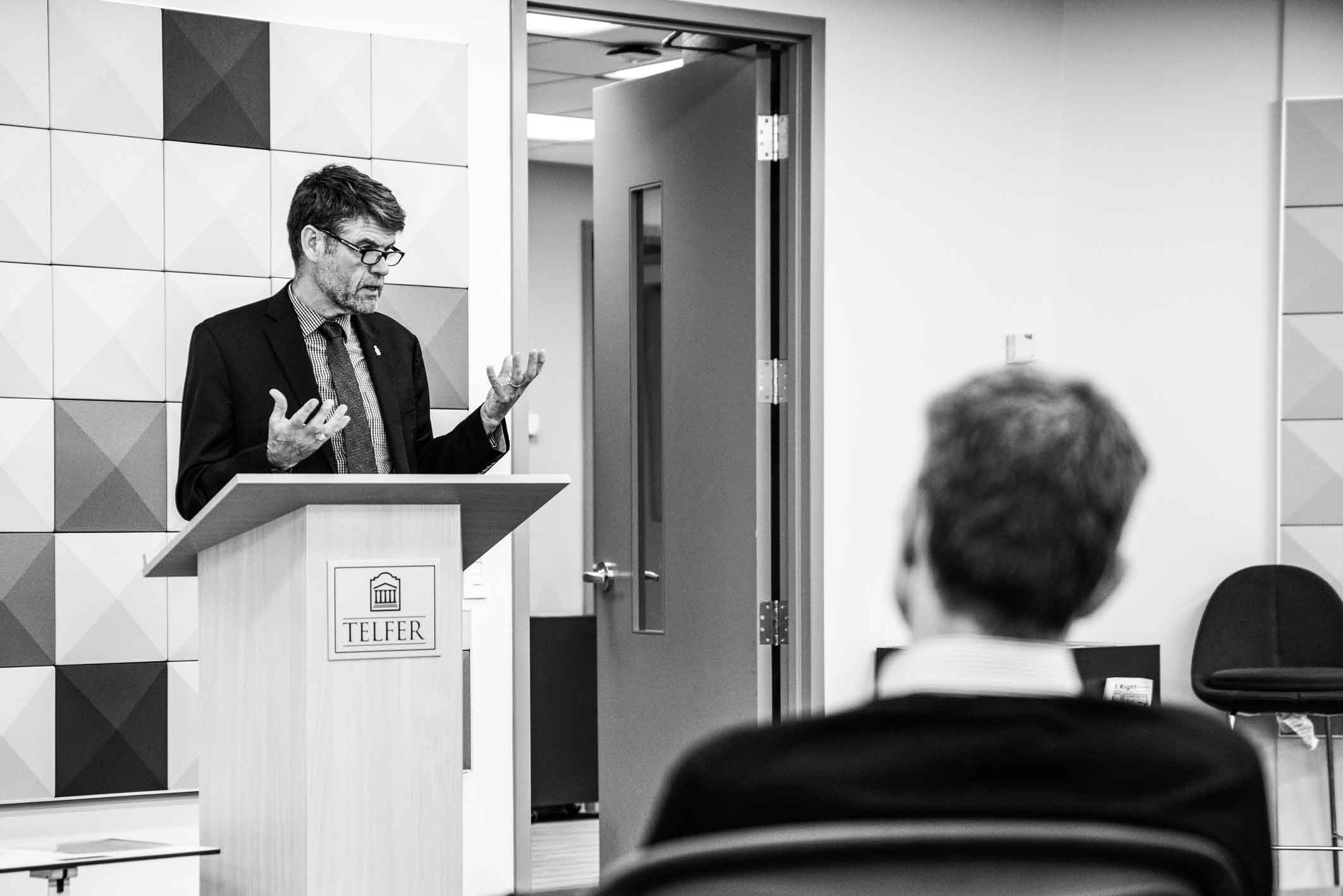 Cybersecurity expert Paul Rutherford presenting at the Canadian Defence Procurement conference at the Telfer School of Management in Ottawa