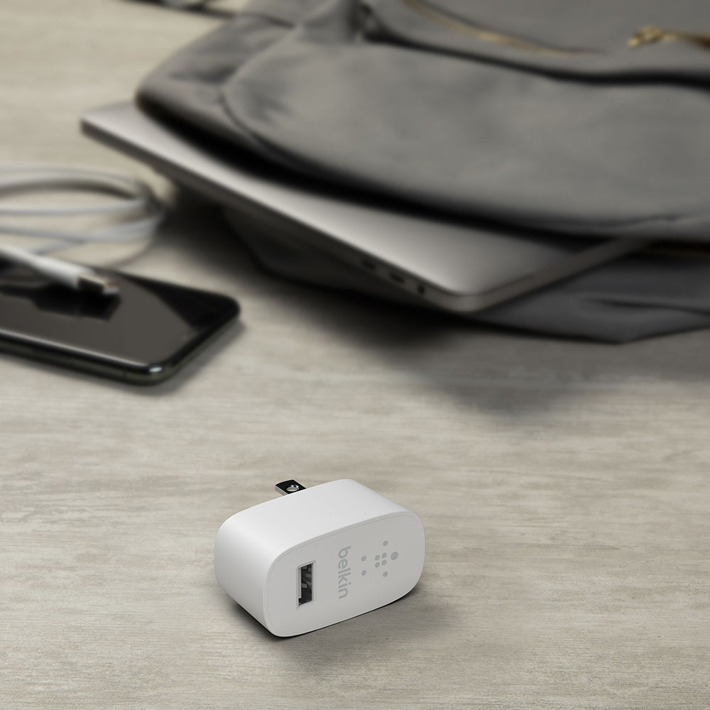 Belkin wall charger laying on a table