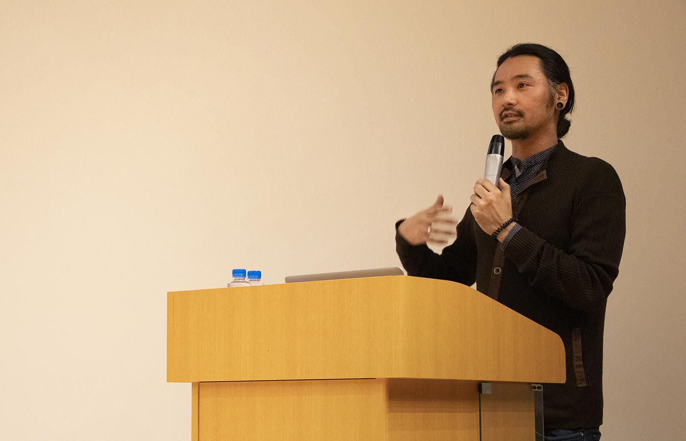 Keisuke Suzuki from the University of Sussex at the podium