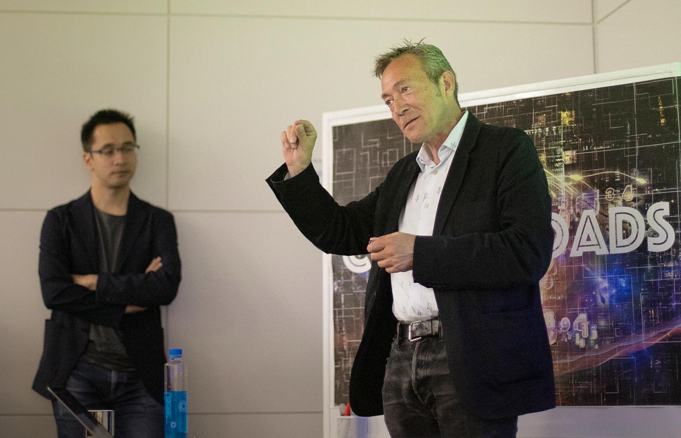 Professor Axel Cleeremans presenting to the Cross Roads audience