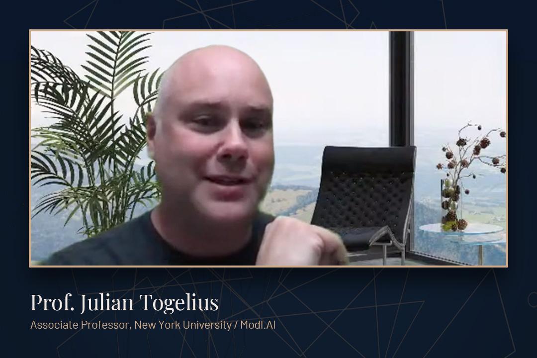 Prof. Julian Togelius speaking via zoom