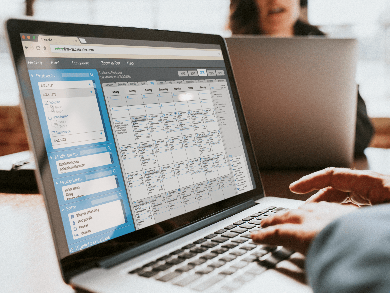 A person using the digital treatment calendar on their laptop