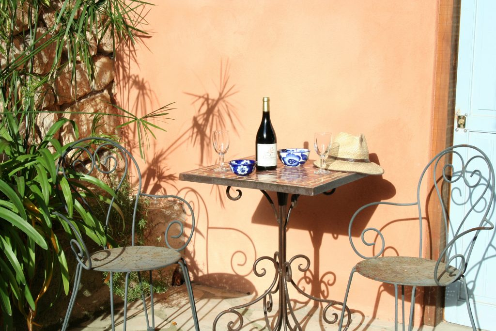 Olive Grove apartment outside table and chairs to enjoy your coffee and croissant!
