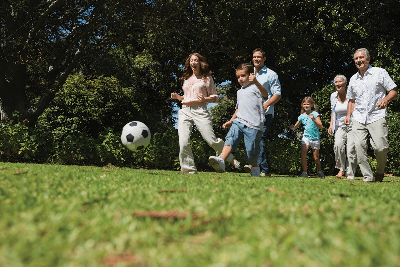 Family out with soccer ball