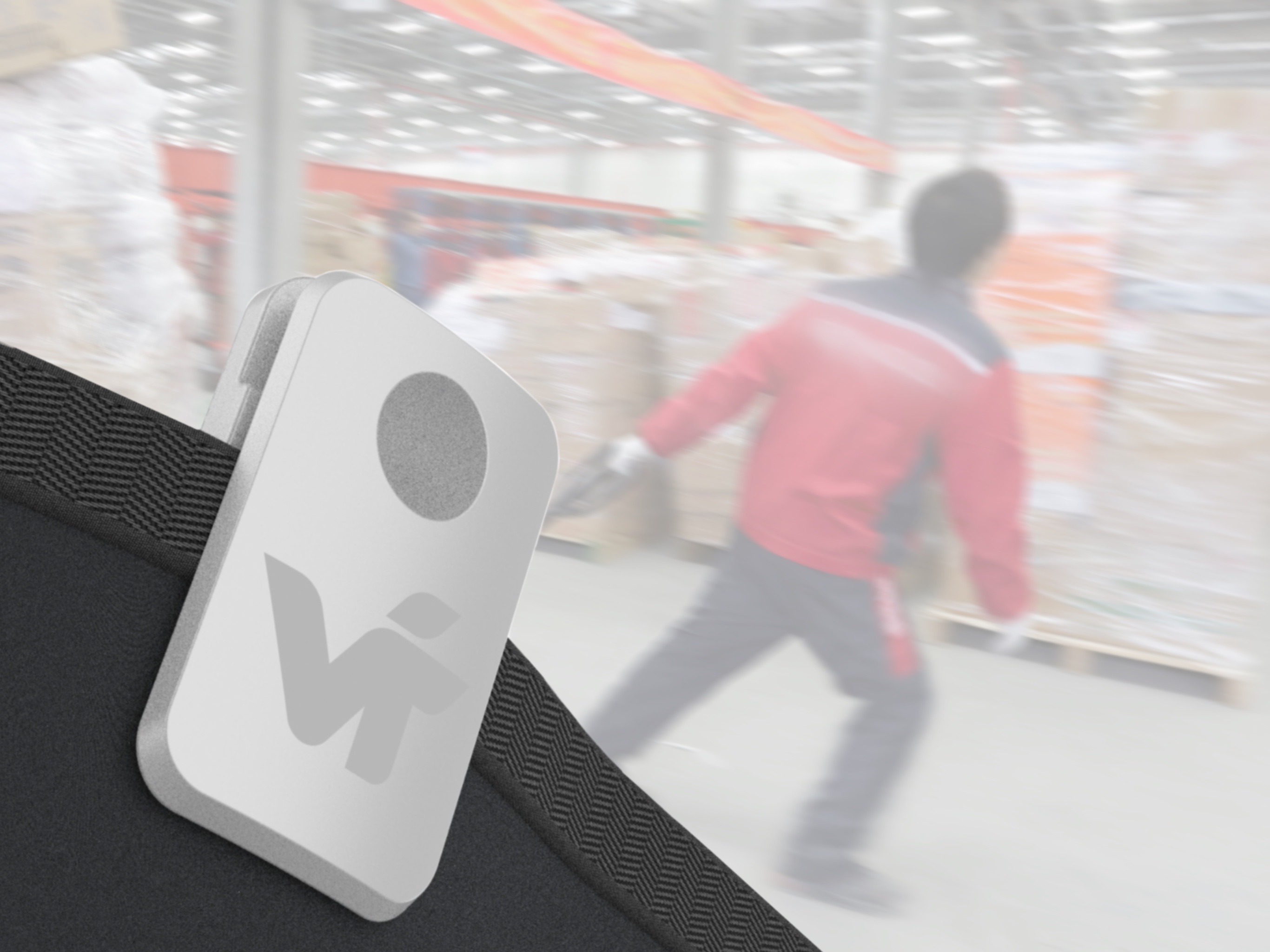 An employee wearing VIT's Arc wearable device on their back.