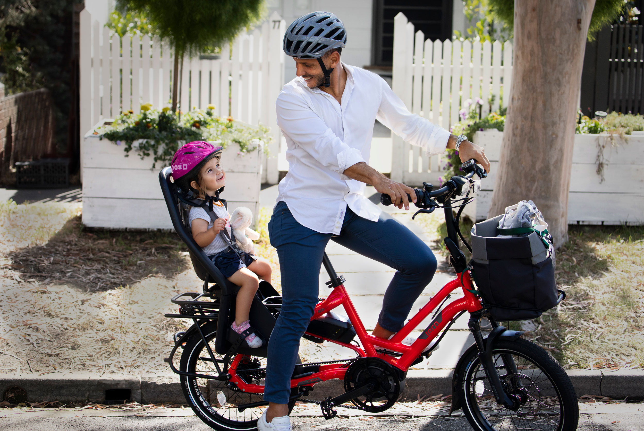 Dad and baby on a red Tern HSD family bike