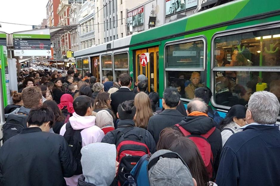 people waiting on tram