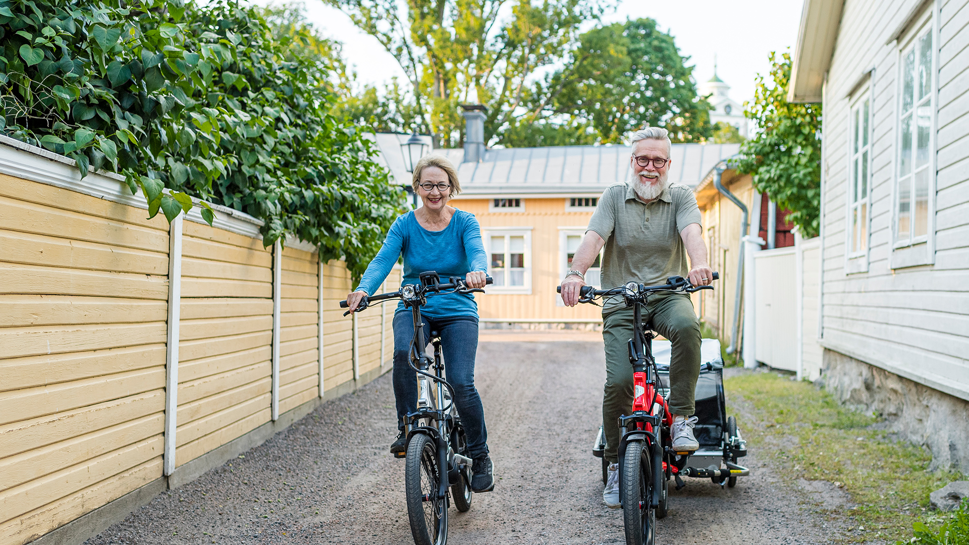 a pair of elderly people riding Tern HSDs
