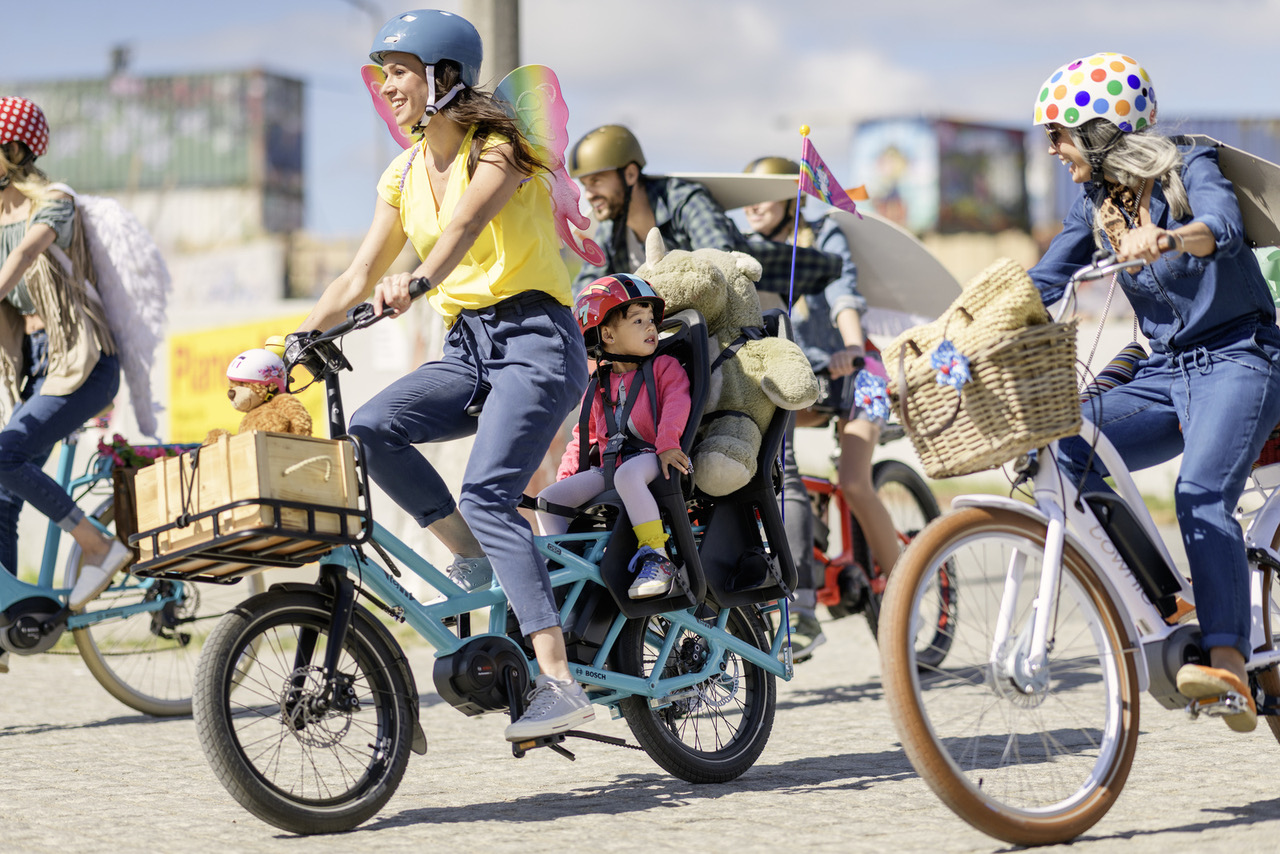 woman and child smiling while riding a blue Tern GSD