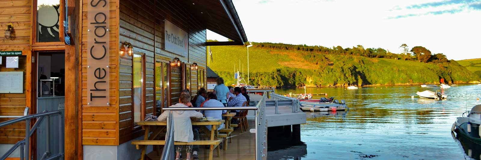 The Crab Shed Salcombe restaurant - waterside seafood dining overlooking the harbour