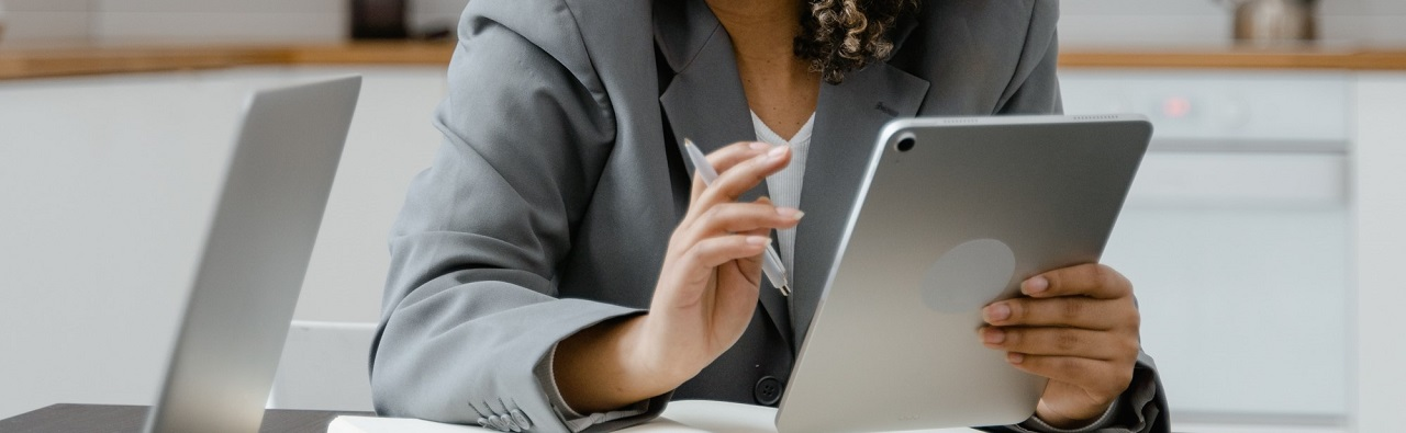 Woman holding a tablet.