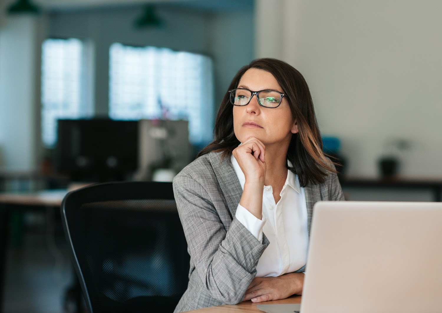Competency-based interview: A business woman looking contemplative