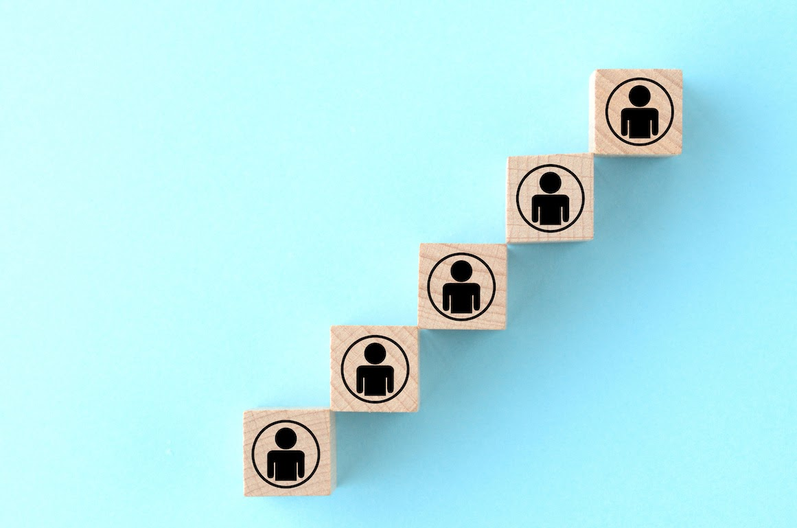 Intake meeting: Wooden blocks with image of person on them in a staircase pattern