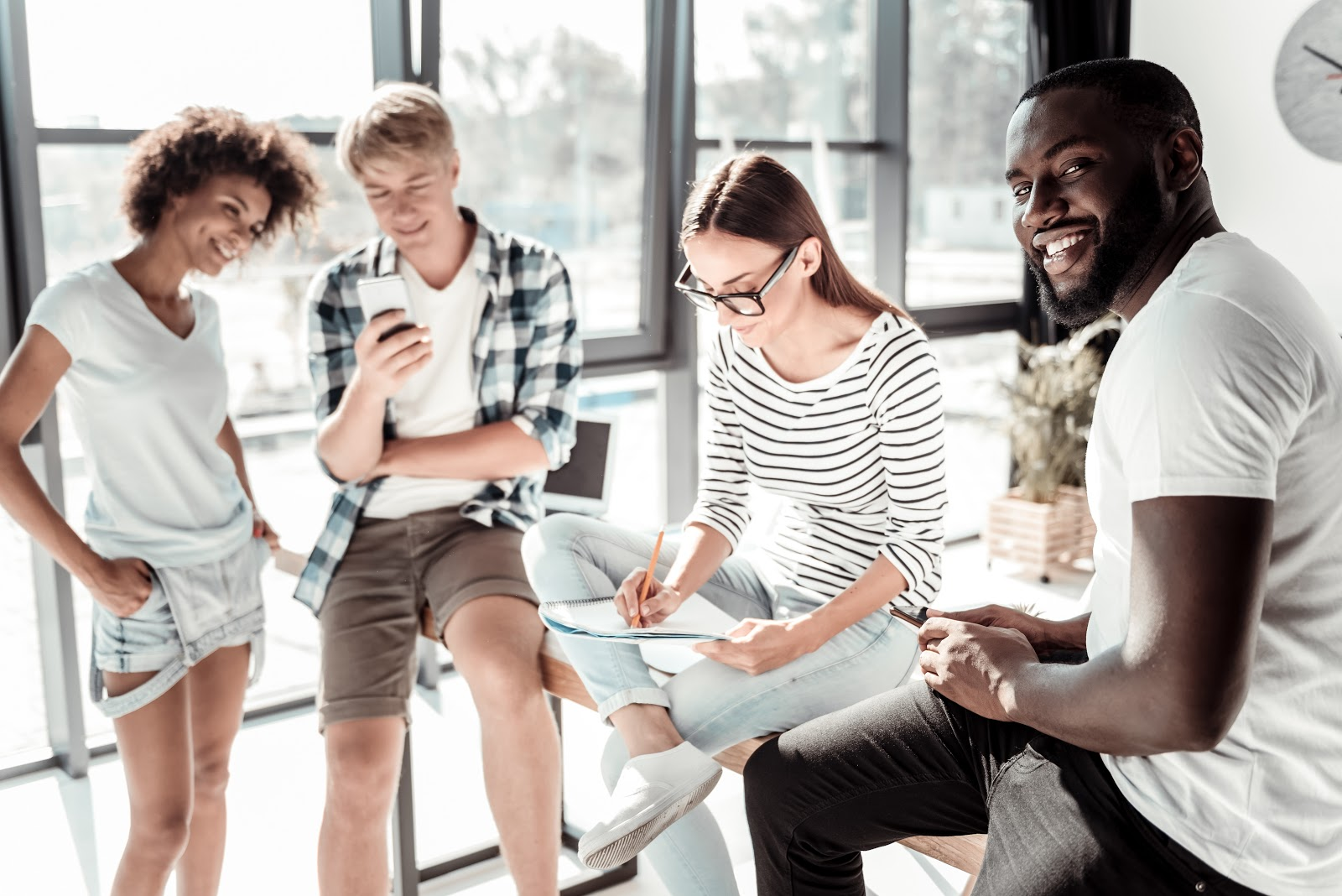 Cost of hiring an employee: Group talking and laughing together