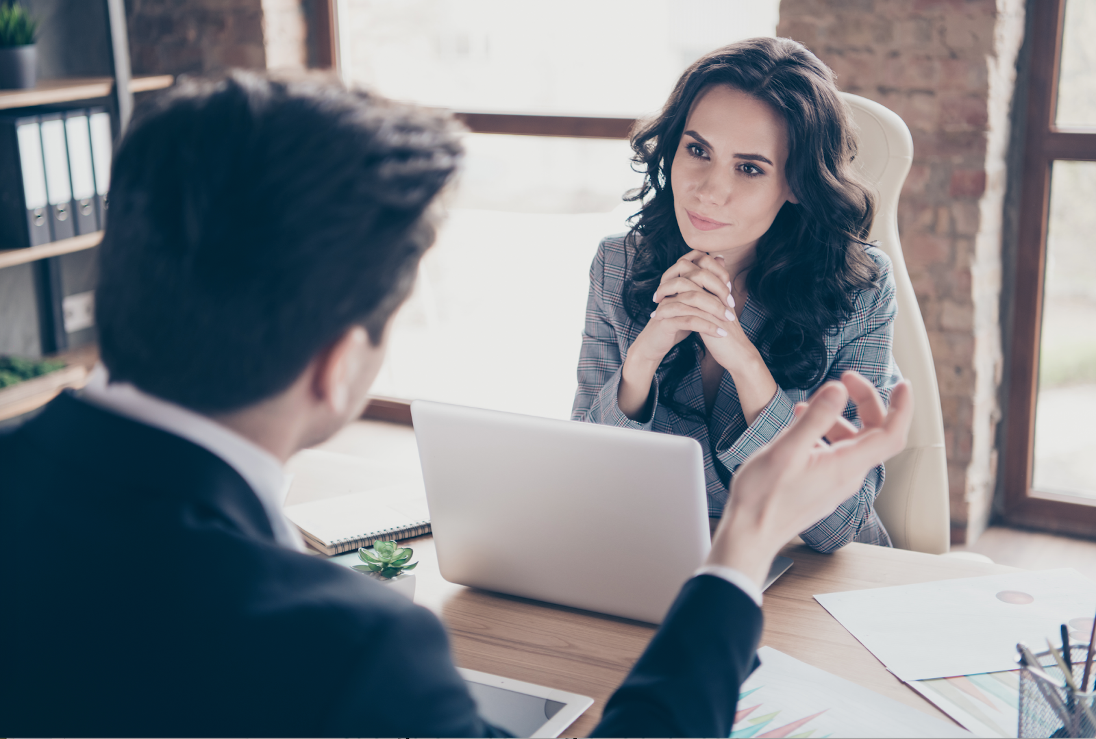 Strengths based recruitment: Woman interviewing an applicant
