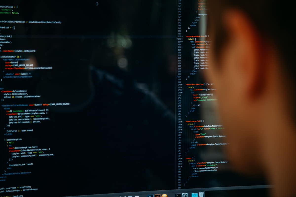 Person looking at code on screen doing the vetting process
