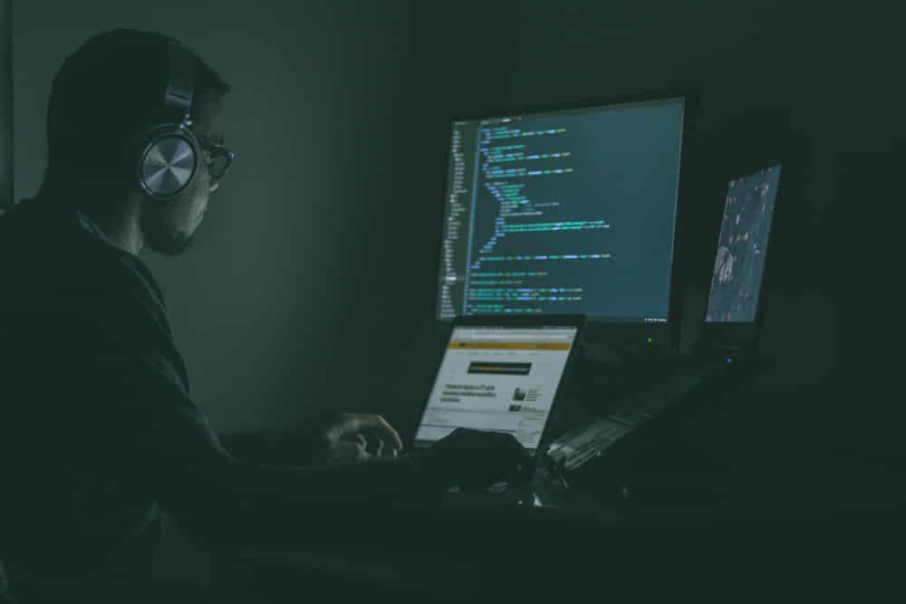 Man coding in the dark