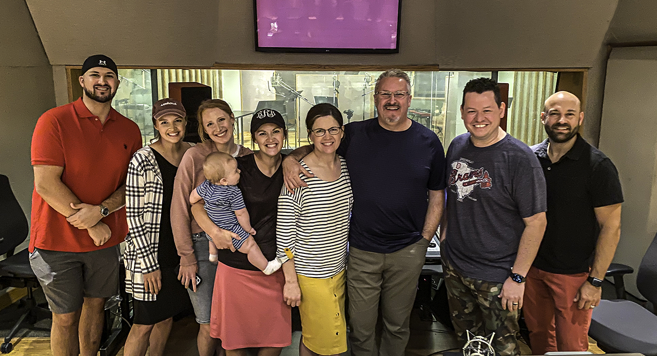 A picture of The Collingsworth Family with producer Bradley Knight and engineer Adam Pleiman