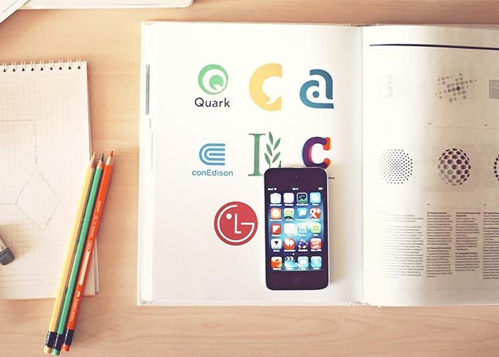 Iphone on a book of logos