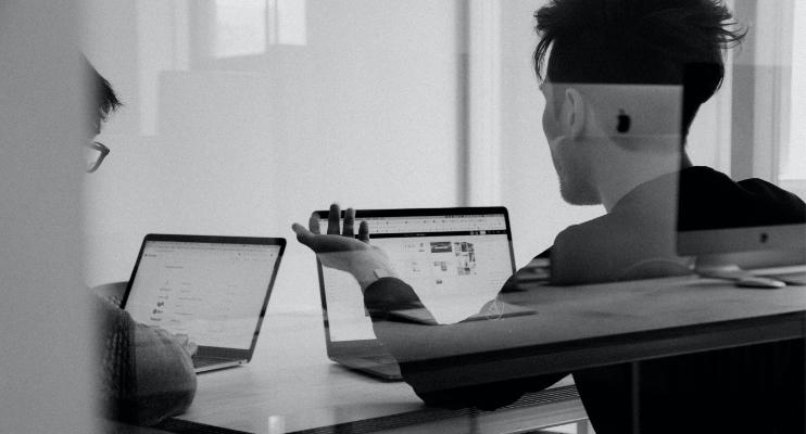 A designer staring at a screen.