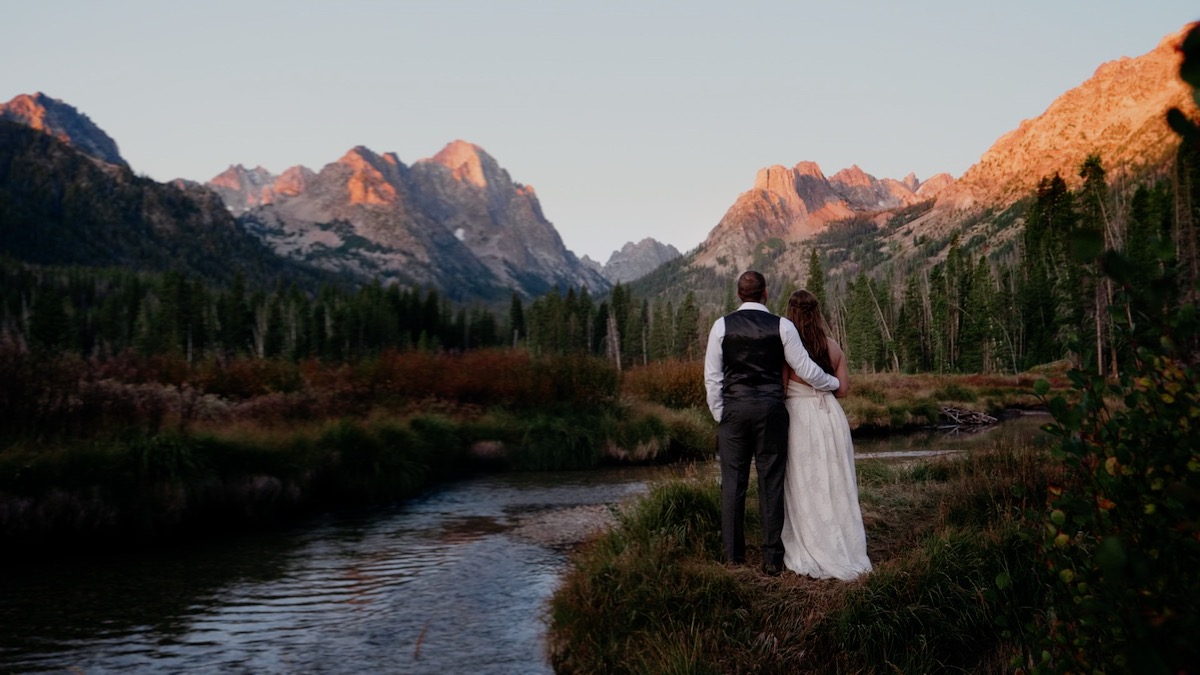 A bride and groom eloping in the mountains
