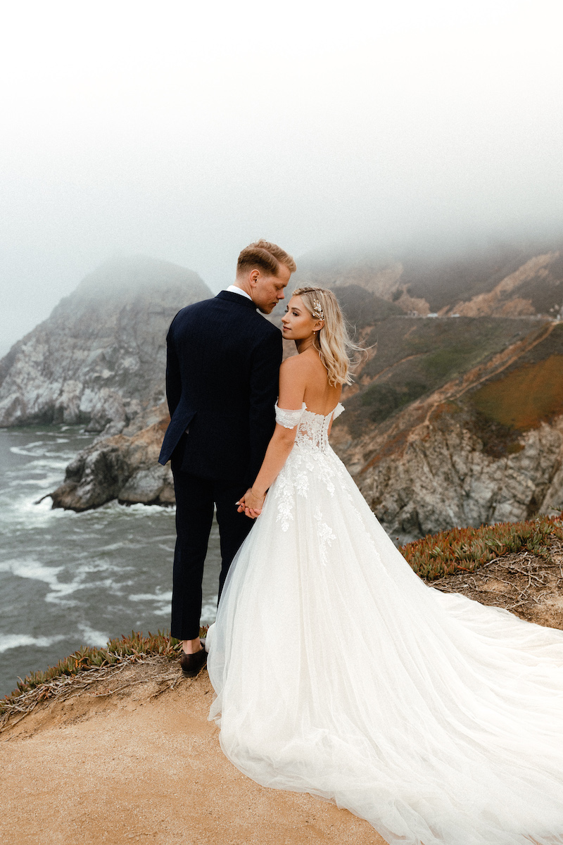 Bride and groom enjoying the the coastal view after their elopement ceremony