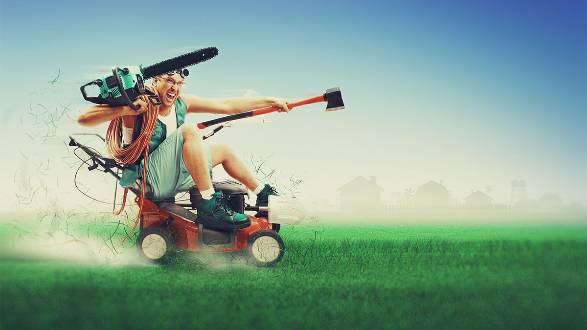 Stock photo of man riding a lawn mower.