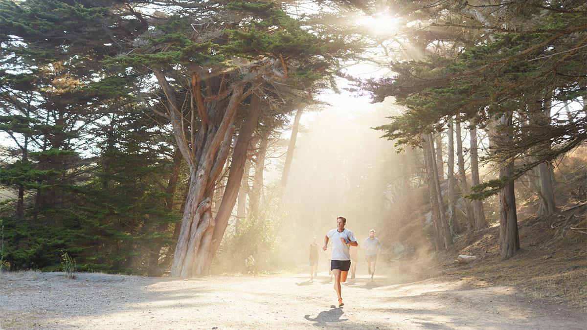 Man running a west-coast trail.