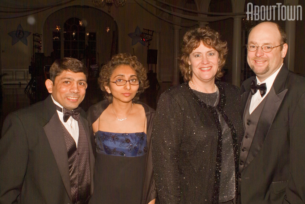 Minesh and Nalini Patel,  Melanie and Eric Hallman