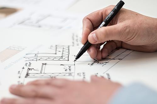 hand drawing a blueprint