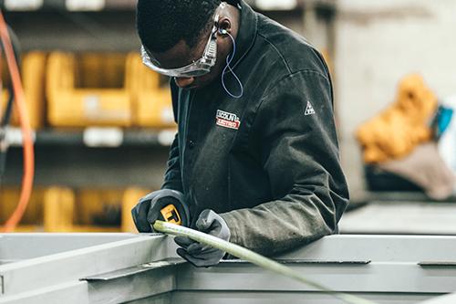 Man measuring steel