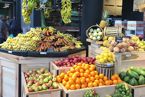 store with colorfull fruits placed in crates