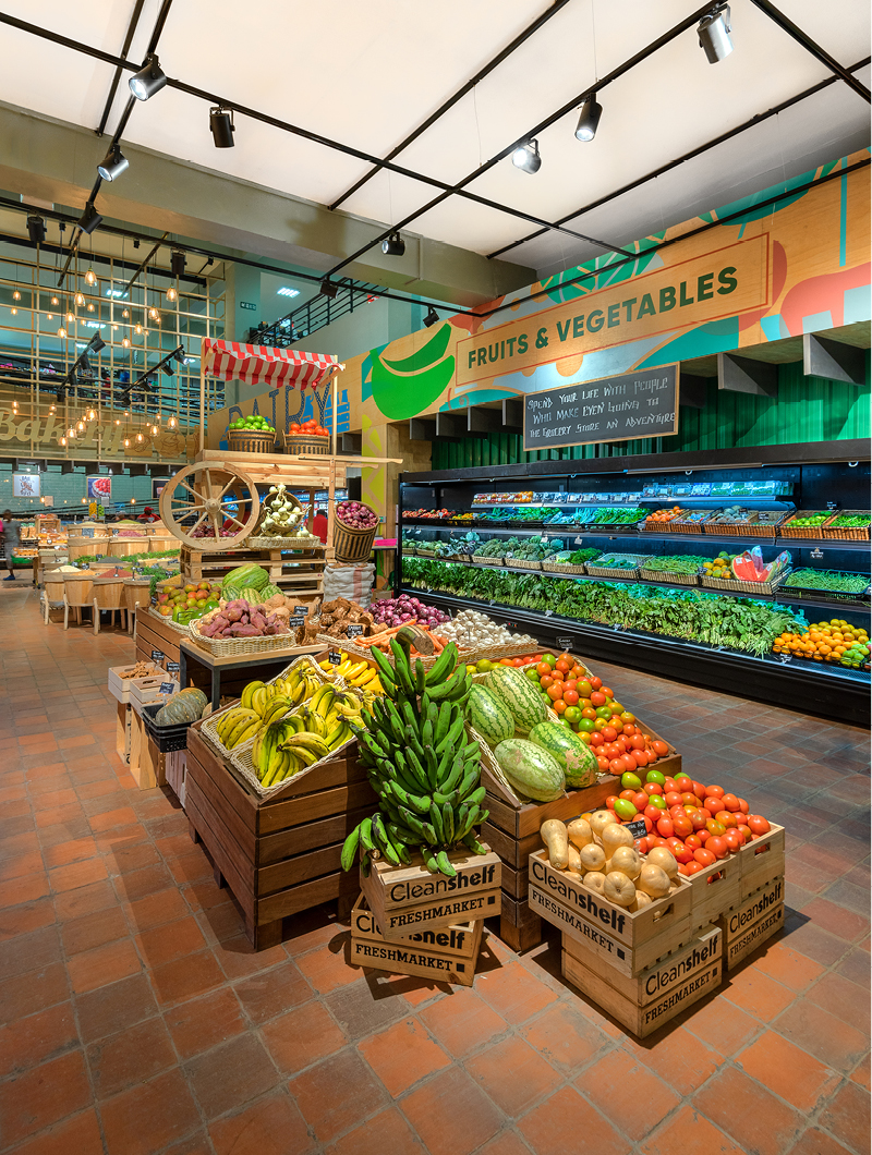 supermarket filled with colourful fruits